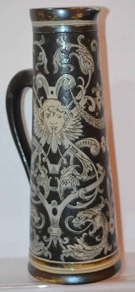 A LARGE MARTIN BROTHERS LEMONADE JUG WITH GROTESQUE DESIGNS.