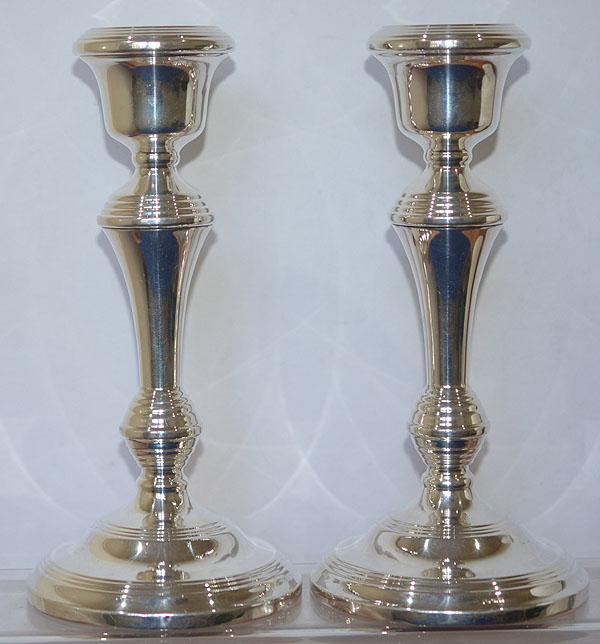 PAIR OF SILVER CANDLE STICKS.